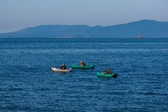 Fishermen on inflatable boats stock photo
