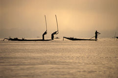 Fishermen in Inla lake, Myanmar. Fischermen in thier boat in the waters of the famous Inle lake in Burma (Myanmar Royalty Free Stock Photography