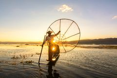Silhouette of fisherman at sunset Inle Lake Burma Myanmar royalty free stock photo