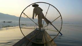 Fishermen in Inle Lake at sunrise, Shan State, Myanmar stock video footage