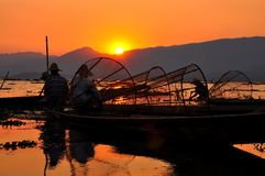 Fishermen in Inle lakes sunset. Stock Image