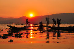 Fishermen in Inle lakes sunset. Stock Photo