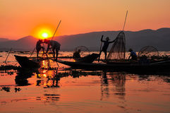 Fishermen in Inle lakes sunset. Stock Photography