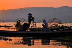 Fishermen in Inle lakes sunset. Royalty Free Stock Photography