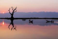 Fishermen in Inle lakes sunset, Myanmar. Royalty Free Stock Photos