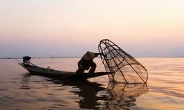Fishermen in Inle lakes sunset, Myanmar. Stock Photos