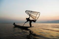 Fishermen in Inle lakes sunset, Myanmar. Royalty Free Stock Image