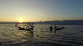 Fishermen from Intha ethnic group of Shan state, Inle Lake. Inle Lake, Myanmar-20, December 2015. Traditionally dressed fishermen from Intha ethnic group of Shan stock footage