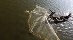 Fishermen on Irrawaddy river throwing fishing nets stock image