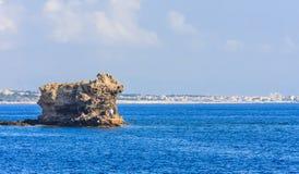 Fishermen on the island near the coast. Rhodes Island Royalty Free Stock Image