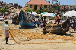 Fishermen on Kovalam Beach, India. Local fishermen working with their nets getting ready for an evening fishing expedition. Taken at Kovalam Beach, Kerala, India Royalty Free Stock Photos