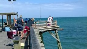 Fishermen  on Kure Beach Pier on east coast North Carolina Stock Images