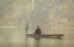 Fishermen in the lake Stock Photography