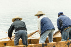 Fishermen on Lake Patzcuaro, Mexico. Three fishermen pull in their net on Lake Patzcuaro, Mexico Stock Photography