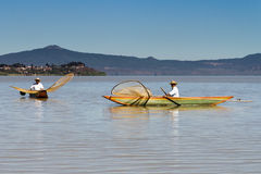 Fishermen on Lake Patzcuaro. Fishermen with their traditional butterfly shaped nets and wooden boats on Lake Patzcuaro, Michoacan, Mexico Royalty Free Stock Photography
