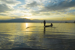 Fishermen in lake Stock Photos