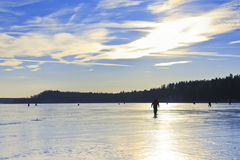 Fishermen on the lake in winter Royalty Free Stock Image