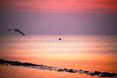 Fishermen leave fishing while the twilight is on at wooden red b stock photo