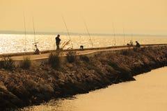 Fishermen in Lisbon Stock Images