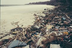 Fishermen live along the coast,. Leaving plenty of waste on the coast and throwing it into the sea. Make the water rot and dead. big mountain of garbage stock photography