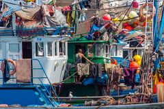 Fishermen live on ships in the port of Essaouira. September 2, 2012 in Essaouira, Morocco, Africa royalty free stock photography