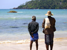 Fishermen looking at the Indian ocean Stock Photo