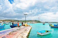 Fishermen on Luzzu colorful boat at Marsaxlokk Harbor on Malta Royalty Free Stock Image