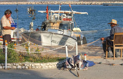 Fishermen mending their nets Stock Images