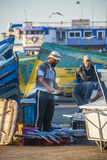 Fishermen in Morocco. Fisherman checks catch of the day in Essaouira, Morocco Royalty Free Stock Photos