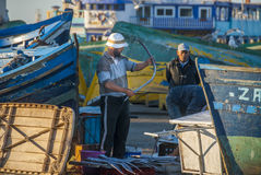 Fishermen in Morocco. Fisherman checks catch of the day in Essaouira, Morocco Royalty Free Stock Photo
