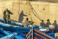 Fishermen in Morocco. Three fishermen preparing a boat for fishing Stock Image