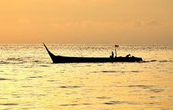Fishermen on a moving boat. Sunset and fishermen on a boat stock images