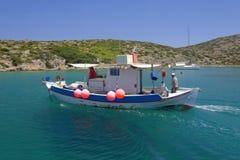 Fishermen nearing Levitha Island Royalty Free Stock Image