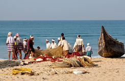 Fishermen with nets stock photos