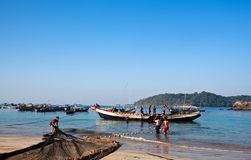 Fishermen with nets Stock Photography