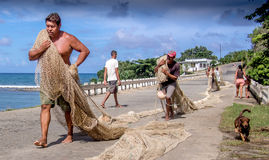 Fishermen with nets Baracoa Cuba Stock Photos