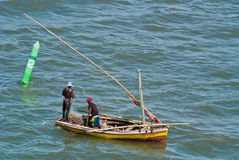 Fishermen and nets in dhow Royalty Free Stock Image