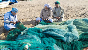 Fishermen Oman preparing nets Stock Images