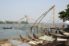 Fishermen operate a Chinese fishing net Stock Photography