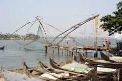 Fishermen operate a Chinese fishing net Stock Photos