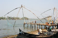 Fishermen operate a Chinese fishing net Stock Images