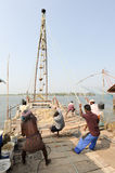 Fishermen operate a Chinese fishing net Stock Photo