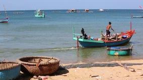 Fishermen at Phu Quoc island, Kien Giang province, Vietnam. Fisherman on boats , Ham Ninh village, Phu Quoc island, Kien Giang province, Vietnam. Phu Quoc is stock video footage