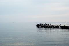 Fishermen on the pier fishing. Black Sea. Crimea. Royalty Free Stock Photos