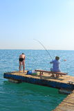 Fishermen on pier Royalty Free Stock Photos