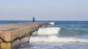 Fishermen on the pier in the sea. (Full HD stock video footage