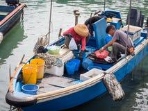 Fishermen prepare their catch. HONG KONG - OCTOBER 28: Fishermen prepare their catch in Sai Kung on October 28,2012 in Hong Kong, China. As a former fishing Stock Photography