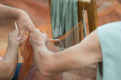 Fishermen preparing fishing nets Royalty Free Stock Images