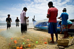 Fishermen preparing nets Royalty Free Stock Images