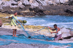 Fishermen preparing nets. Indonesian fishermen prepare fishing nets for fishing.The village of Lamalera on the Indonesian island of Lembata is the last place on stock photography